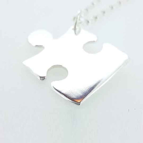 A piece of me - Personalised silver jigsaw puzzle piece necklace.