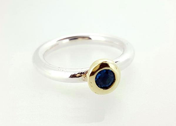 Chunky silver ring with gemstone set in solid gold
