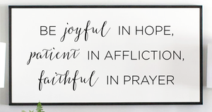 Close view of modern Be Joyful in Hope with black frame