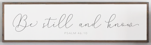 Close up view of Be Still Psalm 46 10 Scripture wood sign