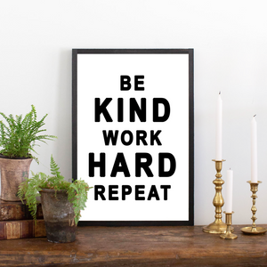 Close Up of Be Kind Work Hard wood sign
