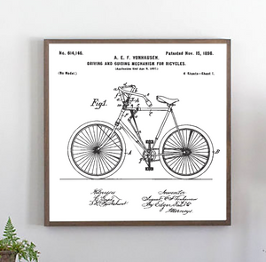 Close view of vintage bicycle patent white wood sign