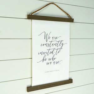 We Are Constantly Invited Hanging Canvas Sign