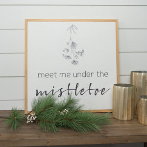 Framed holiday sign with mistletoe message