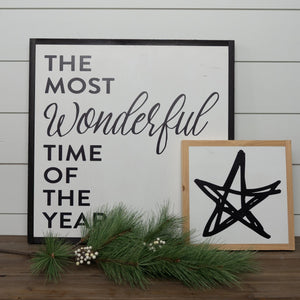 Holiday wood sign with star graphic layered with Christmas sign