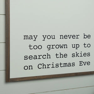 Close up view of search the skies on Christmas Eve holiday sign
