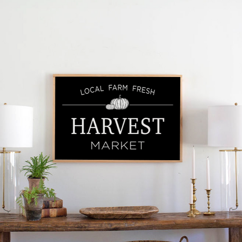 Black framed wood sign with Harvest Market