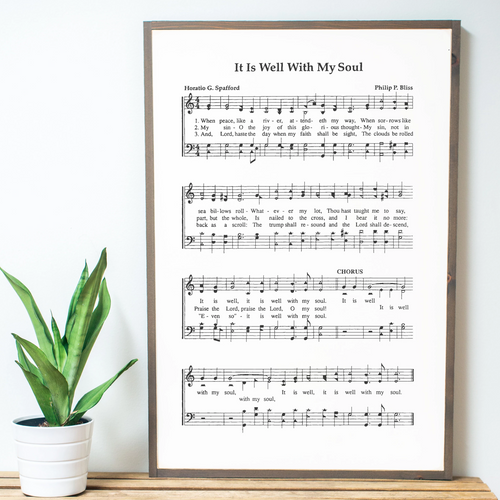 Close up view of Framed wood sign with It Is Well sheet music
