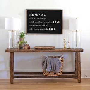 Framed farmhouse sign with black background and kindness quote