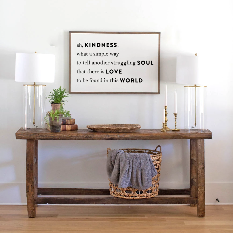 White background wood sign with Kindness quote