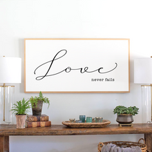 Load image into Gallery viewer, Love never fails sign with natural wood stain frame