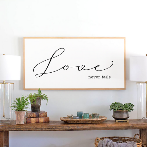 Love never fails sign with natural wood stain frame