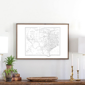 Framed wood sign of Texas map