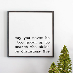Framed sign with black frame with holiday message for Christmas Eve