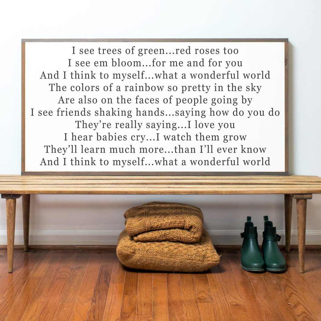 Landscape orientation farmhouse sign with what a wonderful world lyrics