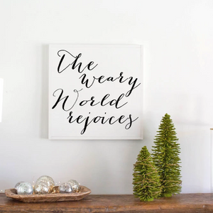 The weary world rejoices wood sign with white frame