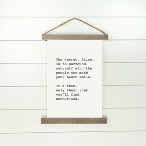 Hanging canvas sign with Alice in Wonderland quote
