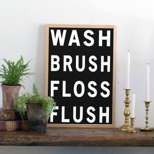 Black background farmhouse sign with wash brush floss flush