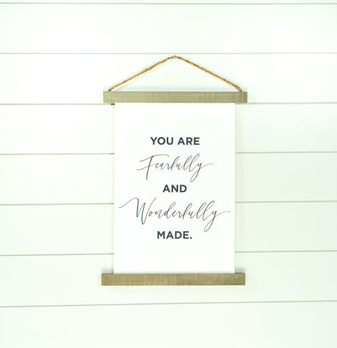 Fearlessly and wonderfully made hanging canvas sign