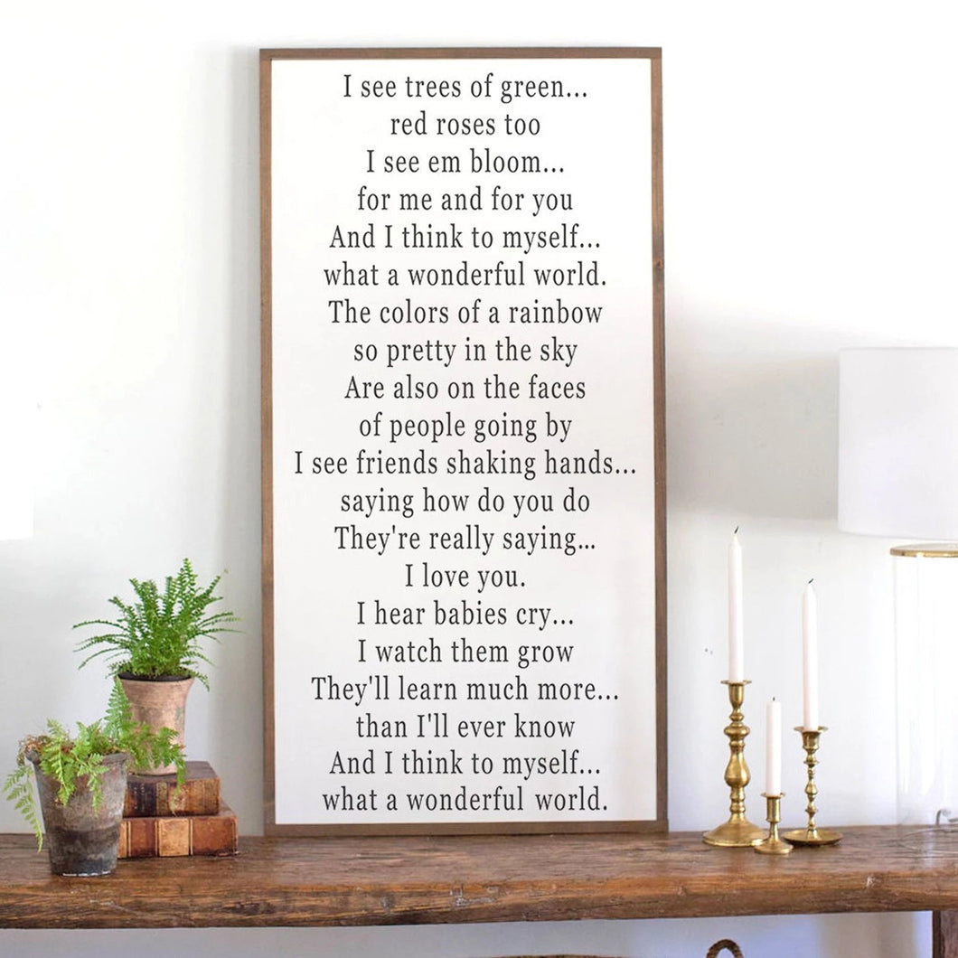 Framed farmhouse wood sign with vertical orientation of What a Wonderful World lyrics
