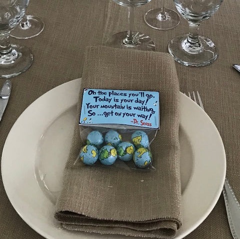 Favor bags with Dr. Seuss quote and world theme chocolates