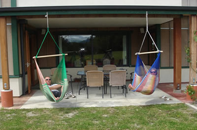 Hanging chair hammocks from overhead beam