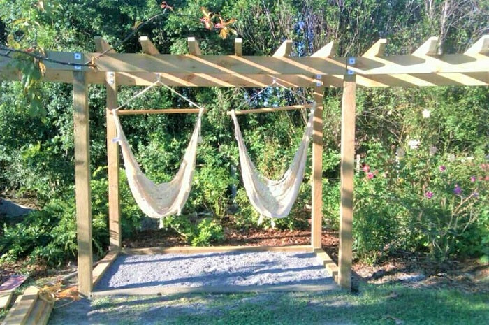 Chair hammocks hanging from pergola