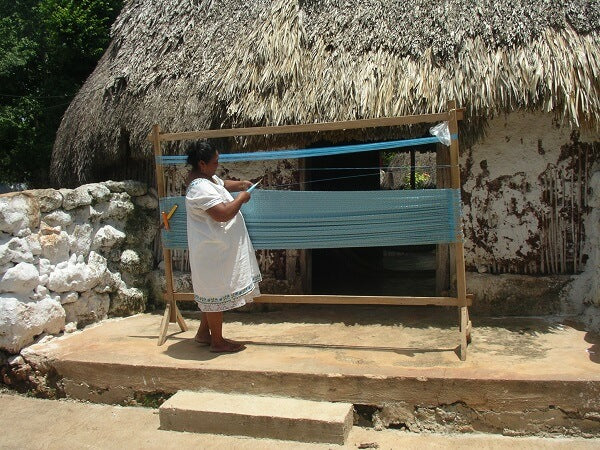 Traditional hammock weaving in the home