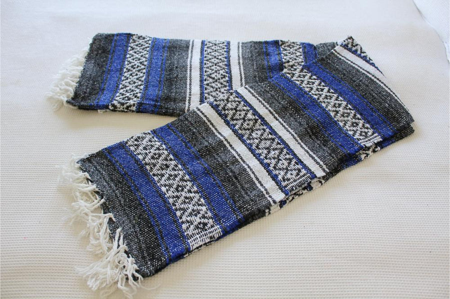 Blue, grey and white striped Mexican blanket