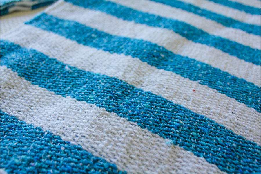 Light Blue and White Woven Falsa Blanket
