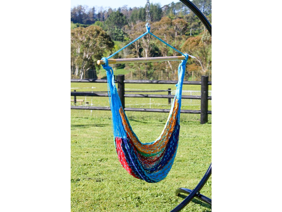 Hammock chair hanging from metal frame