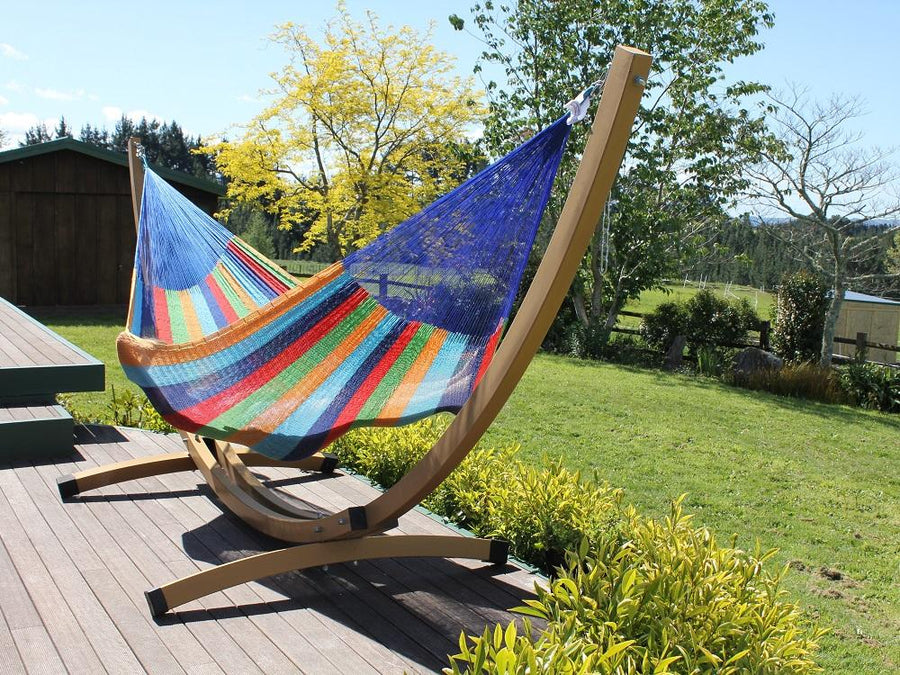 Rainbow coloured cotton hammock and free standing frame