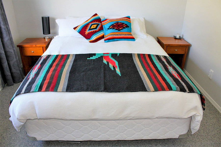 Mexican Blanket half folded on bed