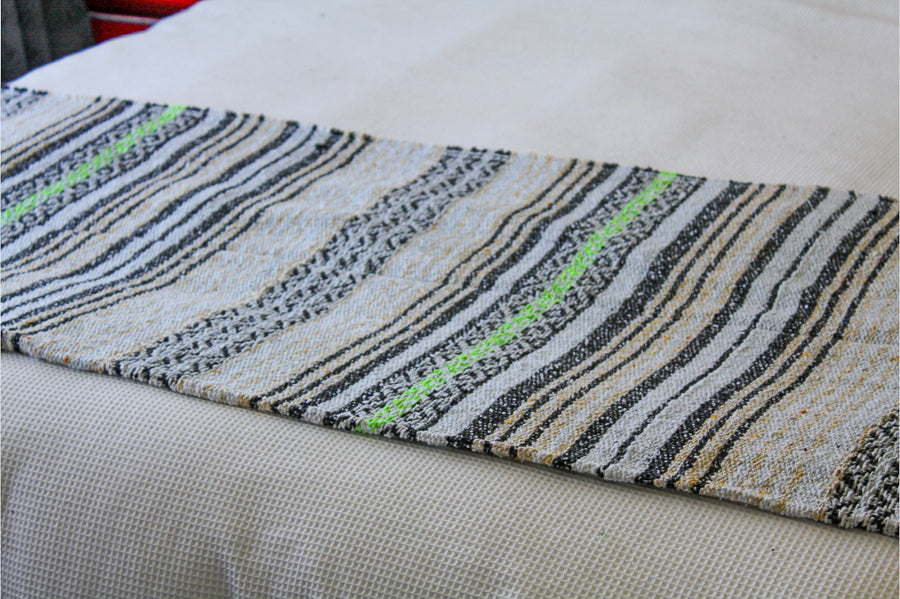 Black, white, lime and beige Mexican striped beach blanket