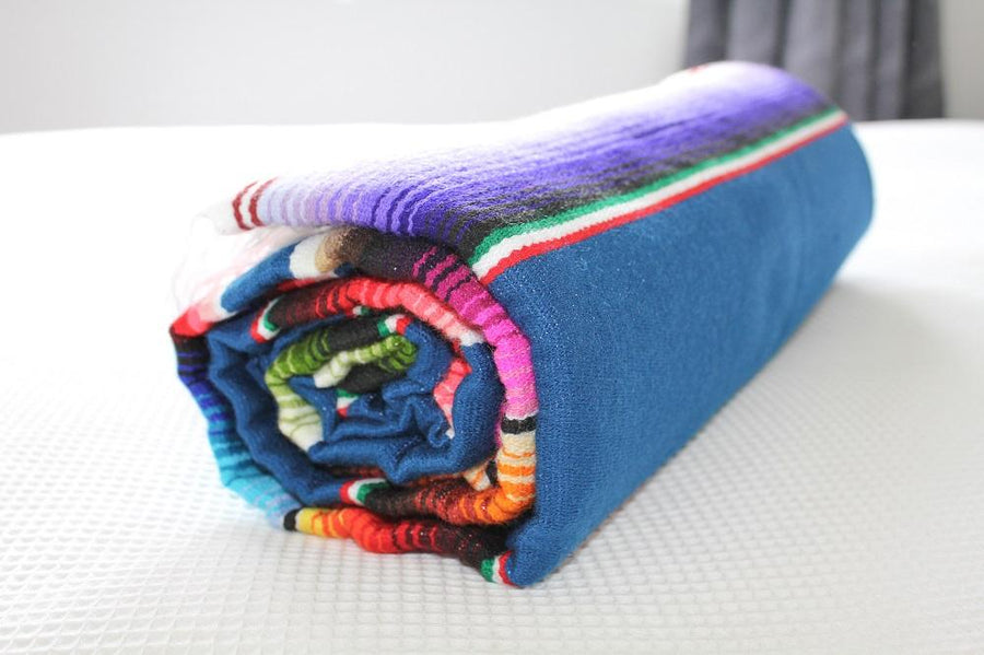 Rolled up Mexican serape blanket
