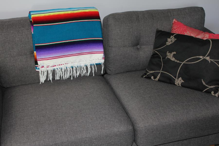 Mexican blanket adding colour to couch