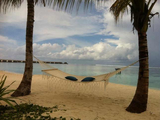 Wooden bar hammock on beach