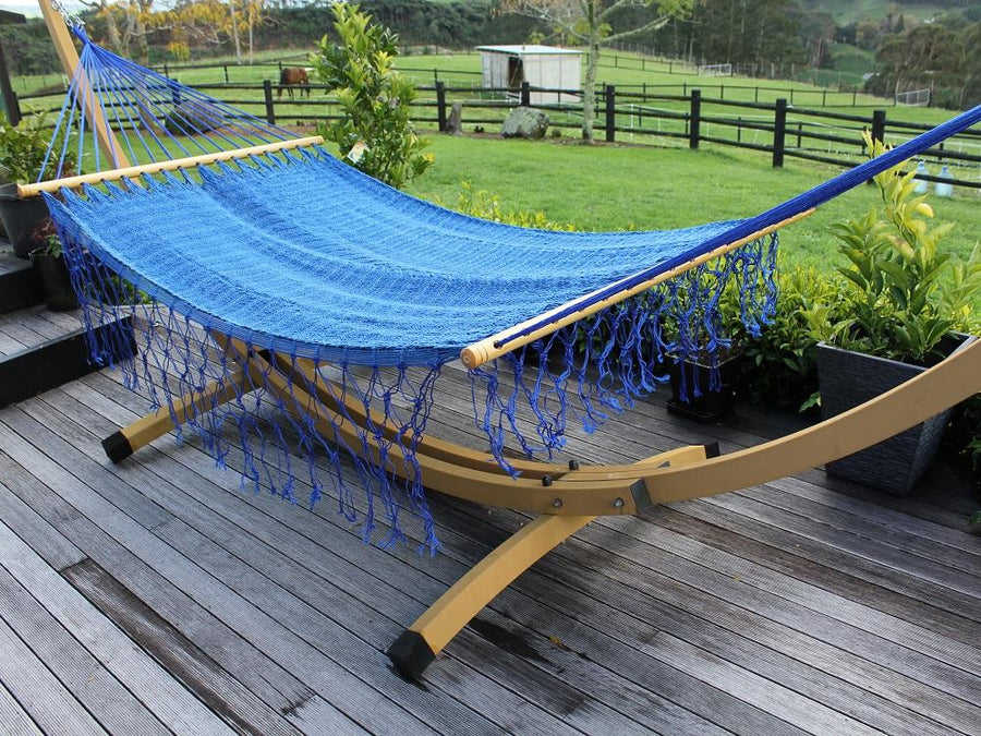 Metal stand and blue bar hammock