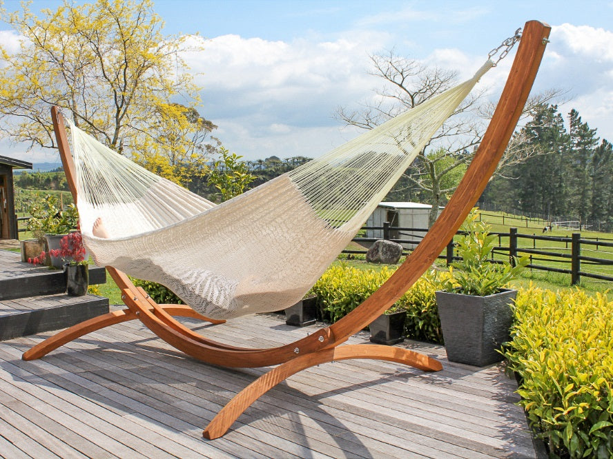 White cotton Mexican hammock and arc shaped hammock stand