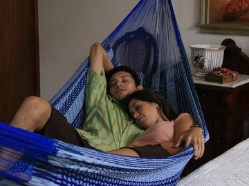 Blue and White Mexican King Size Hammock Hung In Bedroom