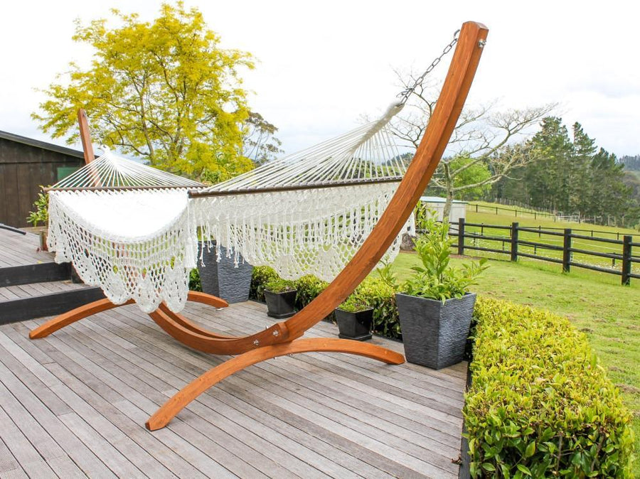 Polyester White Resort Style Hammock with Wooden Hammock Stand on Deck