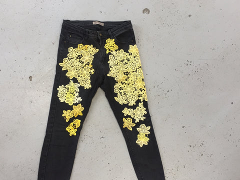 black denim with lots of yellow flowers on it