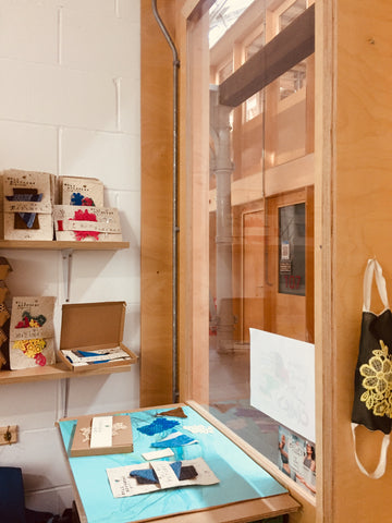 shop display with patches to mend clothes in recycled packaging and DIY kits