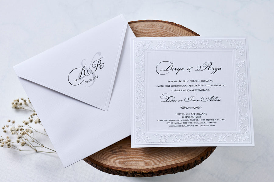 White Envelope with Black Printed Initials and Date Icluding White Embossed Black Printed Insert Wedding and Engagement Invitations