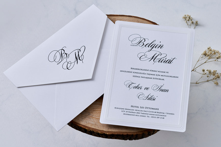 Modest Rectangle White Envelope with Black Initials and Date Including White Embossed Black Printed Insert Wedding and Engagement Invitation