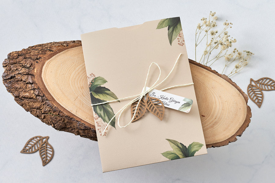 Floral Creme Pouch With Rope Seal Laser Cut Leaf Design And Name Tag With Creme Premium Paper Wedding Engagement and Event Invitations