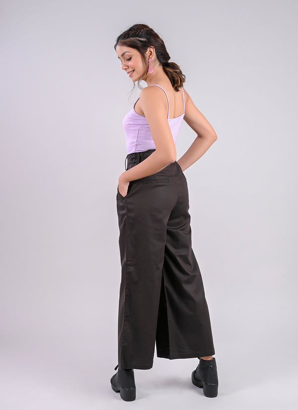 PLEATED PALAZZO PANTS IN CHARCOAL GREY