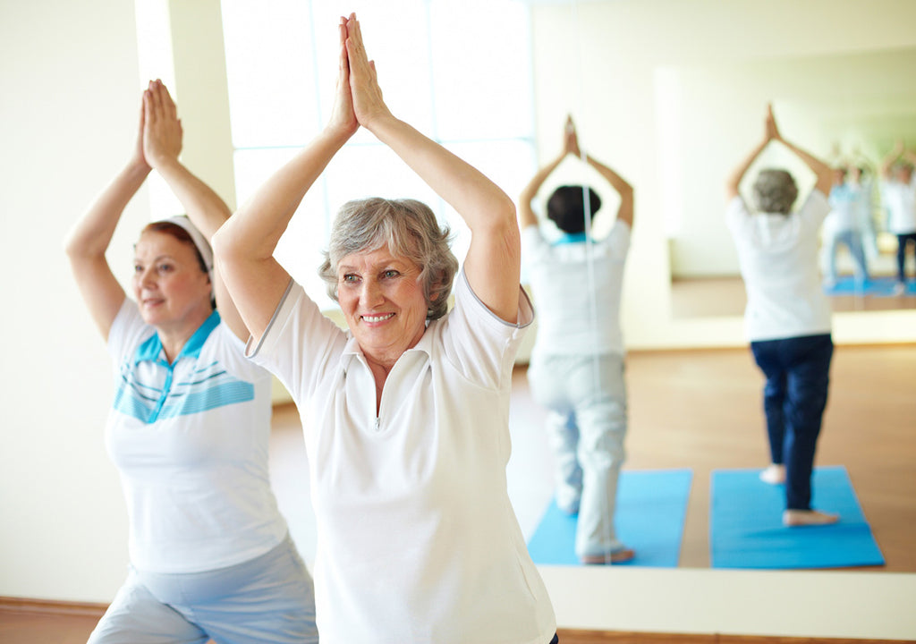 Image of older women doing yoga to stay active as a natural stress relief remedy