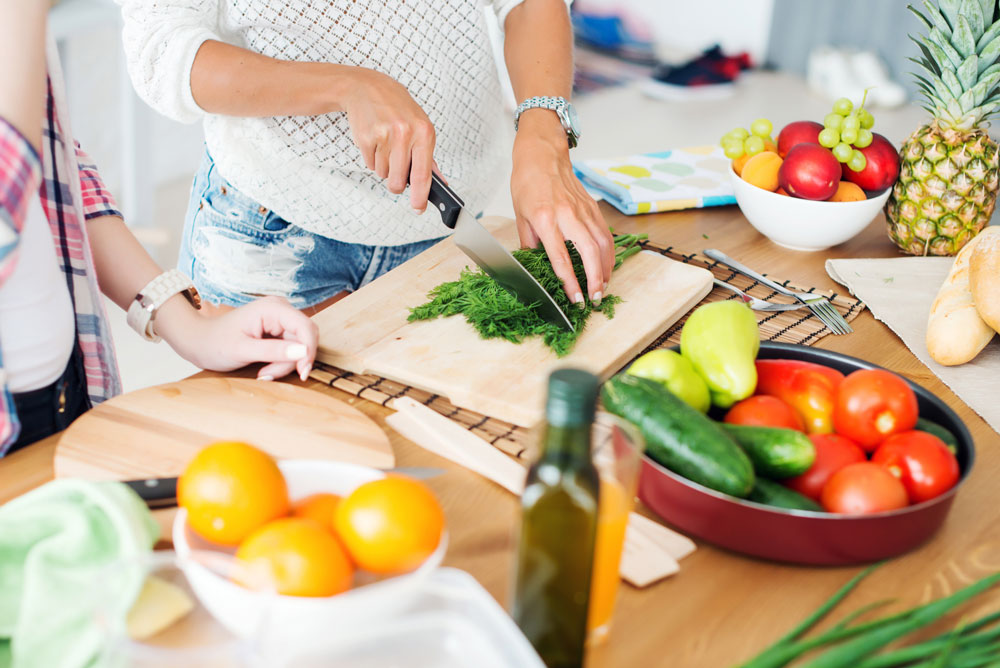 Image of two women preparing a healthy meal