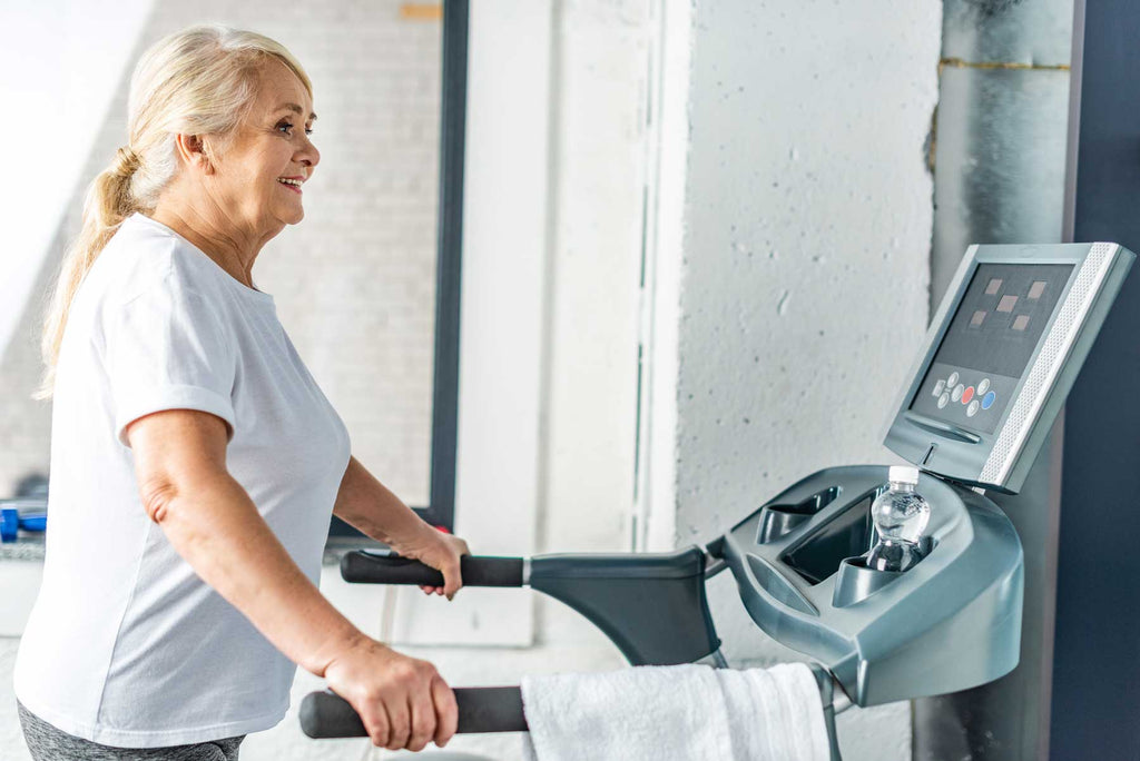 Image of an older woman exercising on a treadmill